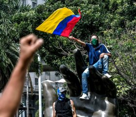 - A man waves a Colombian flag during a protest against the government of the Colombian President Ivan Duque in Medellin, Colombia, on June 5, 2021. (Photo by JOAQUIN SARMIENTO / AFP)